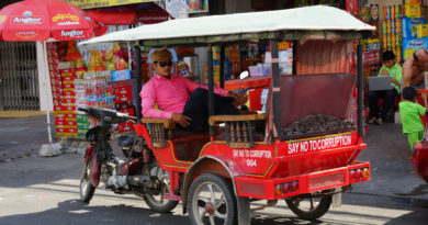 a-phnom-penh-tuk-tuk-driver-relaxing-in-his-vehicle
