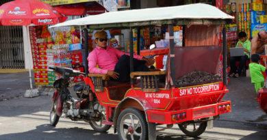 a-phnom-penh-tuk-tuk-driver-relaxing-in-his-vehicle