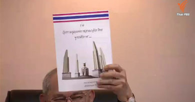 constitution-drafting-committee-chairman-meechai-ruchupan-partly-hidden-holds-up-a-copy-of-the-draft-constitution
