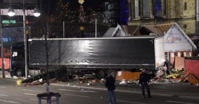 truck-plows-through-berlin-market-one