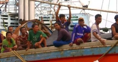 Fishermen on Thai fishing boat
