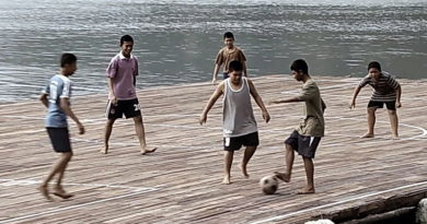 Koh Panyee boys play football on platform