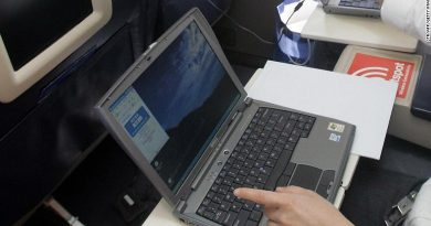 A passenger using a laptop during a recent flight