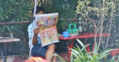 Thai reading morning newspaper