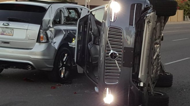 Uber self-driving vehicle flips on its side after an accident