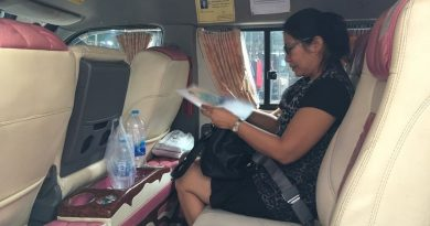 Buckled up van passenger in Bangkok