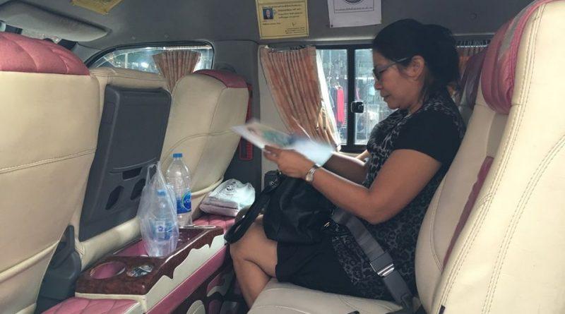 Buckled up van passenger in Bangkok