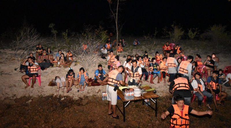 Tourists sheltering on an dam island in Kanchanaburi