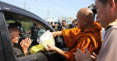 distributing talisman to a Thai driver