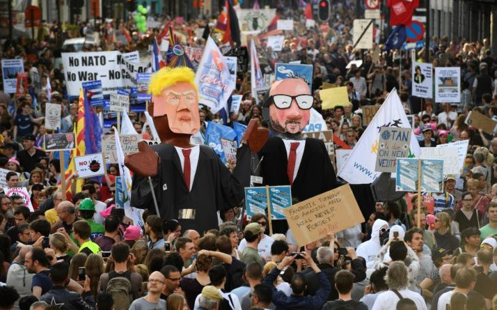 People carry effigies of US President Donald Trump (L) and Belgian Prime Minister Charles Michel during a demonstration againt the US president in Brussels on May 24, 2017.  US President Donald Trump is on a two-day visit to Belgium, to attend a NATO (North Atlantic Treaty Organization) summit on May 25. / AFP PHOTO / Eric FEFERBERG        (Photo credit should read ERIC FEFERBERG/AFP/Getty Images)