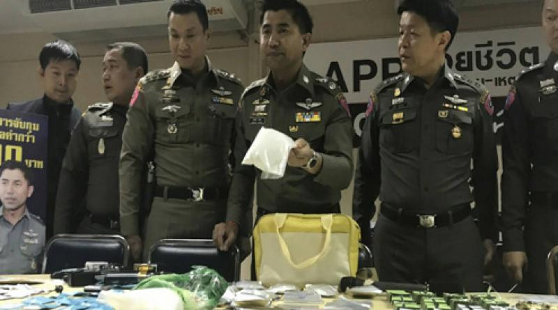 Police with seized drugs, resized