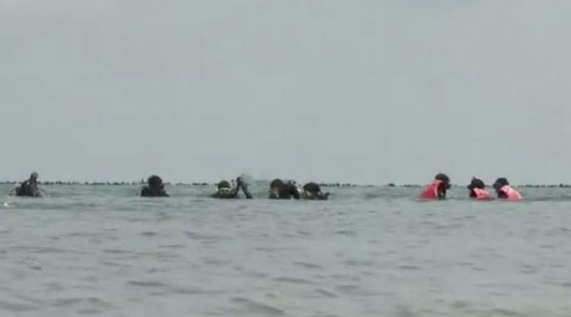 Divers search for body