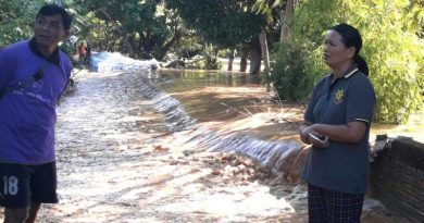 Pasak river flows over breached levee