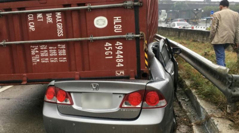 Container falls on sedan