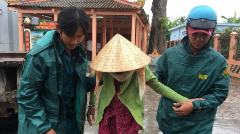 Vietnamese woman helped as storm nears
