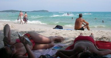 Tourists at Phuket's Chaweng beach