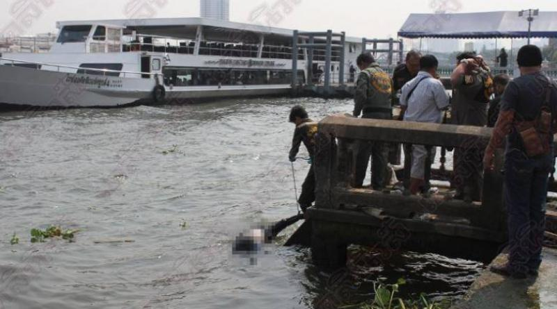 Dead man Yakuza-style tattoos all over floating Chao Phraya river