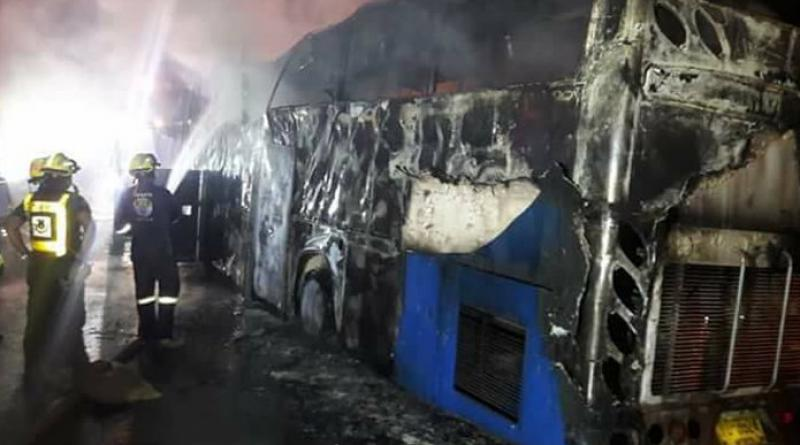 Cigarette Butt Sparked Tour Bus Blaze Killing 20 Workers