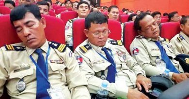 Cambodian cops sleeping on duty