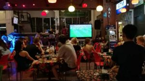 Tourists watching football matches at Khao Sarn road