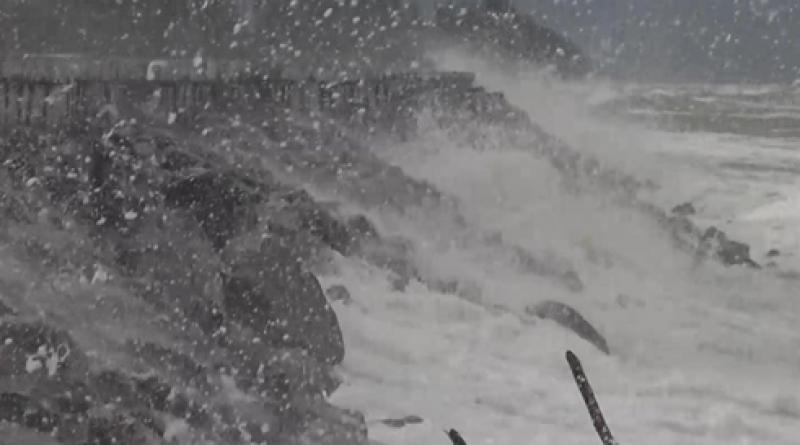 powerful waves hammer beach