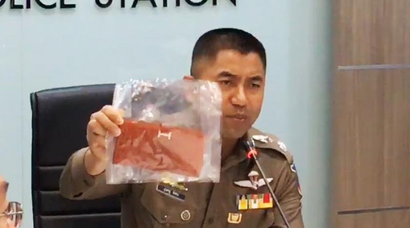 Pol Maj-Gen Surachet showing stolen wallet