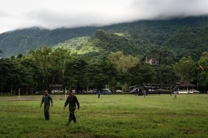 Thai airforce soldiers walk through the football field used by the missing football team near Tham Luang cave, at the Khun Nam Nang Non Forest Park in Chiang Rai province on July 1, 2018 as the rescue operation continues for a missing children's football team and their coach. - Twelve Thai boys and their assistant football coach spent their eighth night trapped in a flooded cave, as a round-the-clock search was aided by better weather. (Photo by Lillian SUWANRUMPHA / AFP) (Photo credit should read LILLIAN SUWANRUMPHA/AFP/Getty Images)