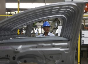 An employee works at an assembly line at the new Ford Thailand manufacturing plant located in Rayong province, East of Bangkok May 3, 2012. Ford Motor Corp is eyeing Indonesia as a production centre to help meet strong demand for cars in Southeast Asia but supply problems mean Thailand will remain its regional hub for the foreseeable future, company executives said. REUTERS/Chaiwat Subprasom (THAILAND - Tags: TRANSPORT BUSINESS) - RTR31JKS