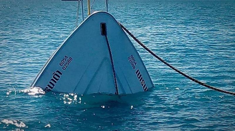 Rescuers raise sunken boat