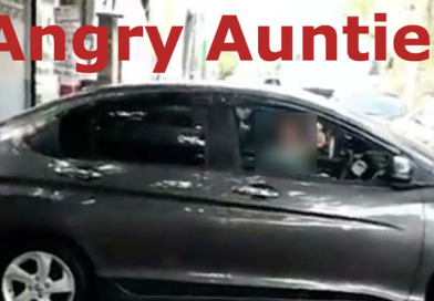 Angry auntie parked her car in the middle of the road to take a nap.