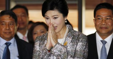Ousted former Prime Minister Yingluck Shinawatra greets in a traditional way as she arrives at Parliament before the National Legislative Assembly meeting in Bangkok January 22, 2015. Thailand's army-stacked parliament will vote in an impeachment hearing against ousted Prime Minister Yingluck Shinawatra on Friday, testing a fragile calm between the rural poor and the royalist establishment backed by the Bangkok middle class. REUTERS/Chaiwat Subprasom (THAILAND - Tags: POLITICS CIVIL UNREST) - RTR4ME8C