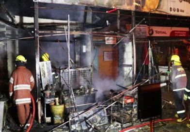 Enemy sets fire to bottled gasoline store.